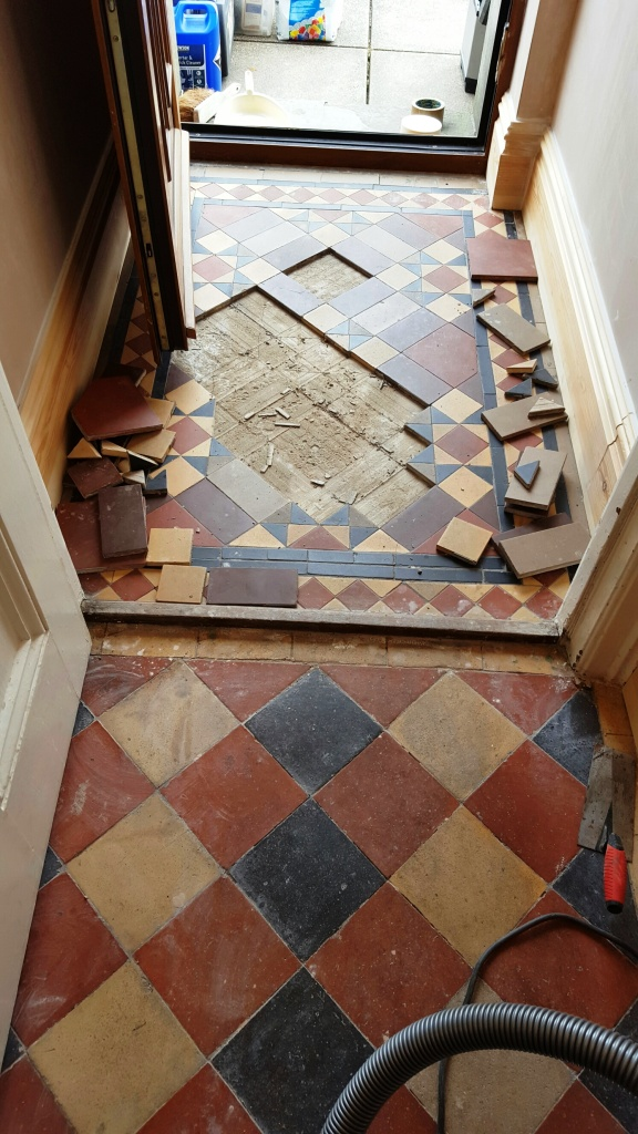 Victorian tiled lobby floor during restoration Swansea