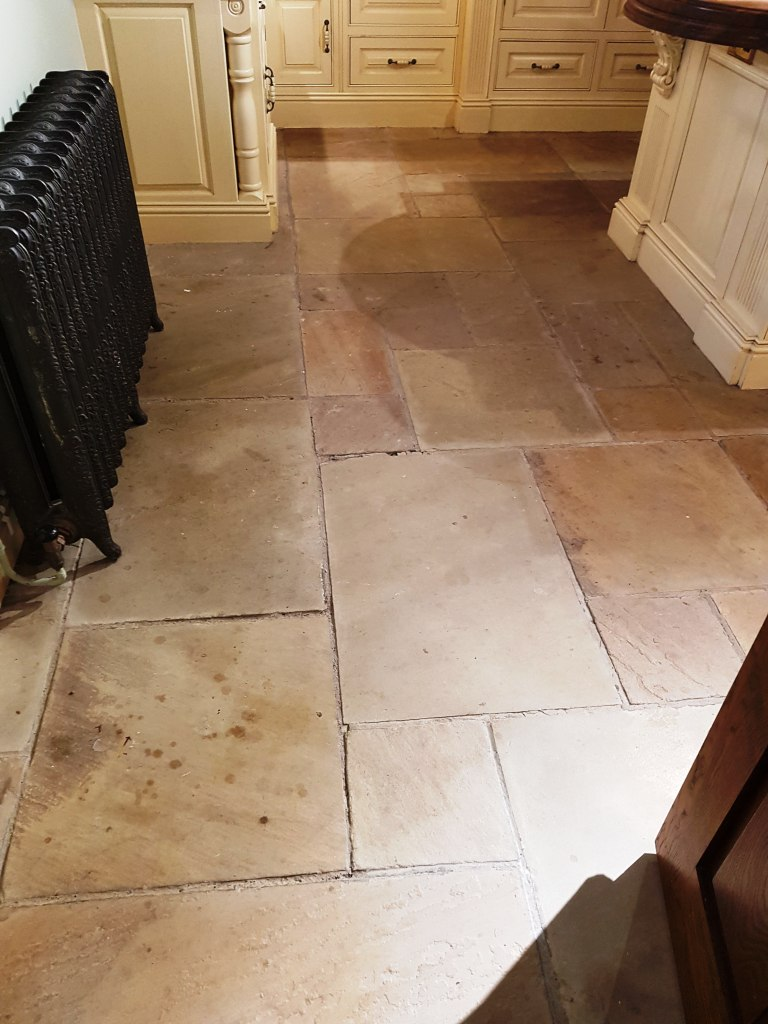 Sandstone kitchen floor renovation for national trust in cheshire sandstone kitchen floor tile before cleaning quarry bank mill cottage dailygadgetfo Images
